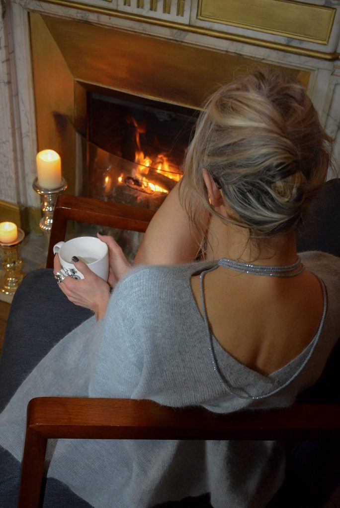 woman-sitiing-in-the-fireplace